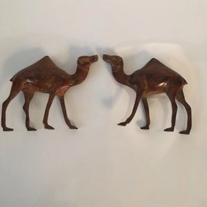 A set of decorative metal camels